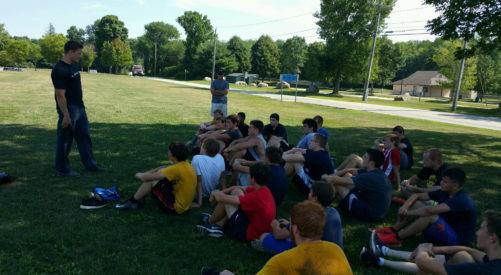 Seth DeValve of the Cleveland Browns talking to the RHAM football  players at Summer workouts